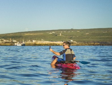 Kayaking along the coastline in Doolin, Co. Clare, Wild Atlantic Way